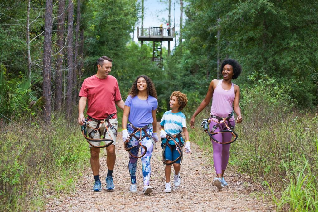 Family of Four On An Outdoor Zipline Adventure