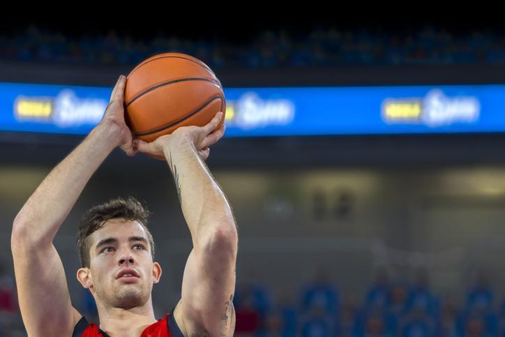 Basketball player shooting a ball
