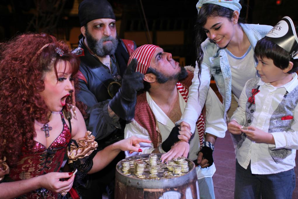A pirate shares his treasure with guests