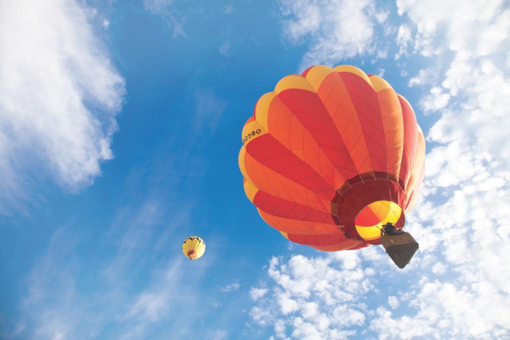 A hot air balloon takes off