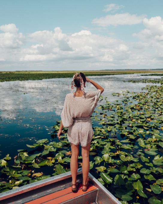 A woman looks out on the water near Kissimmee