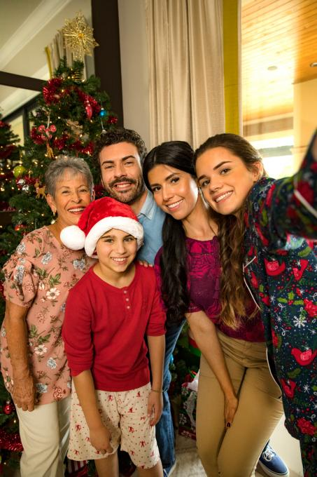 A family poses for a photo at Christmas in their vacation home