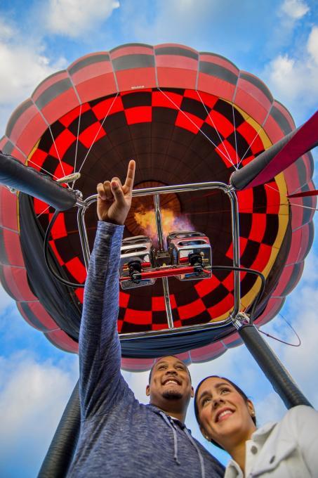 A couple flies in a hot air balloon