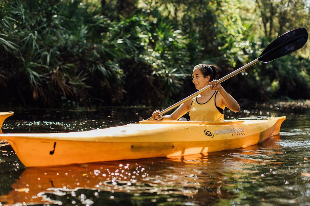 A woman kayaks at the Paddling Center at Shingle Creek
