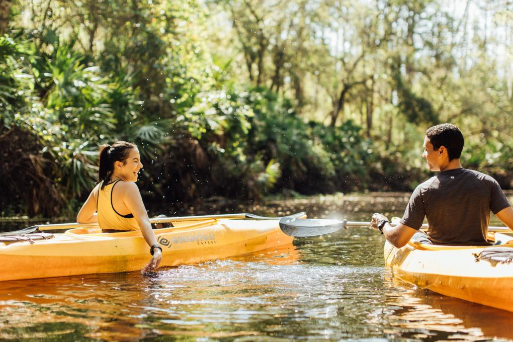 People playfully splash each other at the Paddling Center at Shingle Creek