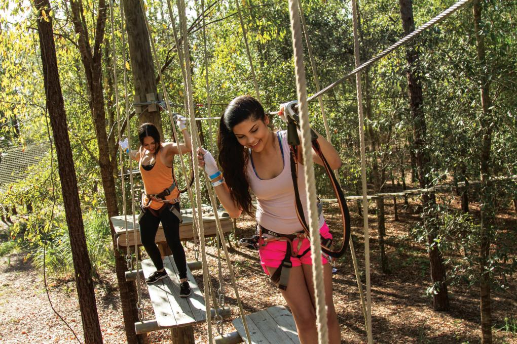 Women tackle the obstacle course at Orlando Tree Trek Adventure