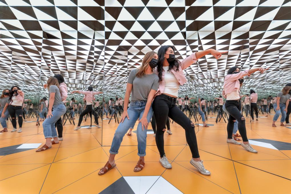 Guests explore the Museum of Illusions