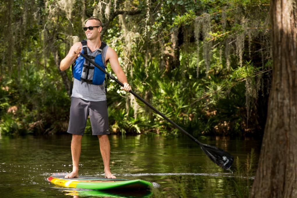 A man rides a paddleboard at the Paddling Center at Shingle Creek
