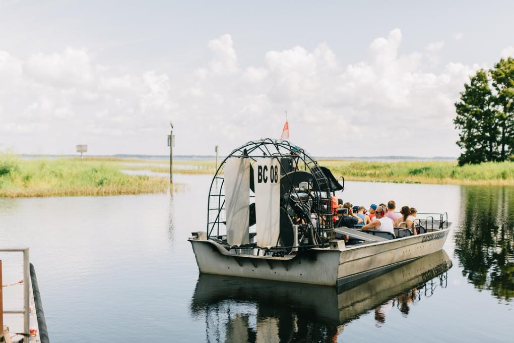 An airboat prepares to leave for a tour at Boggy Creek Airboat Adventures