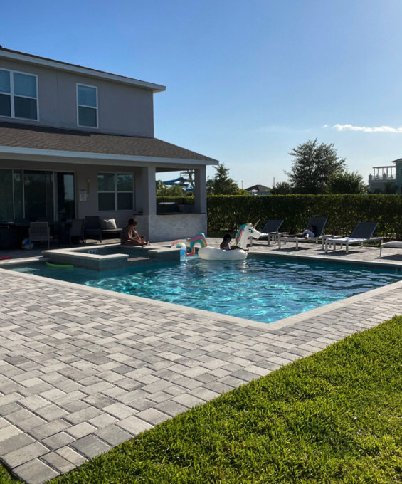 Backyard at the vacation home with a pool on a sunny day
