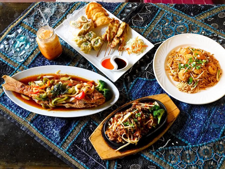 Thai dishes on a table at Thai Thani restaurant, Kissimmee, Florida
