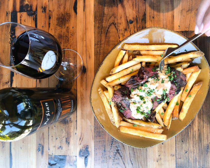 Steak and frites with wine at Wine Bar George, Kissimmee