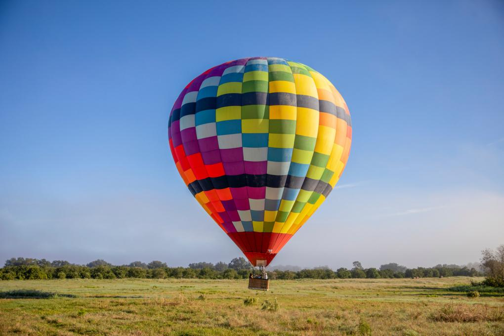 A colorful hot air balloon takes off