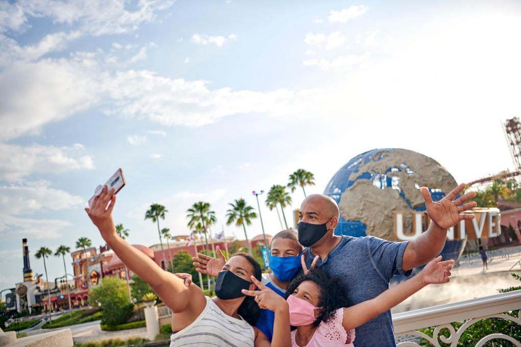 A family poses outside Universal Orlando Resort