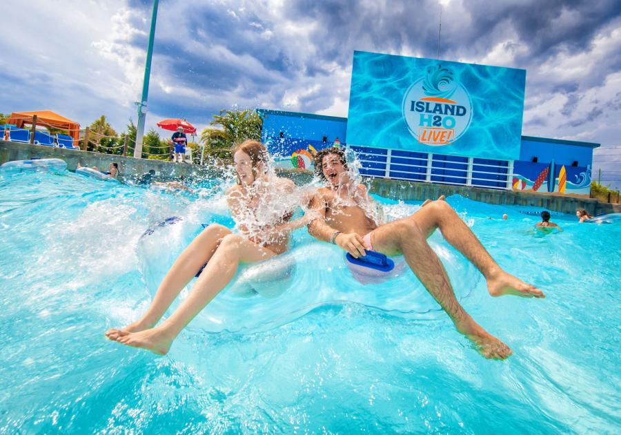 Two people in the wave pool at Island H20 Live