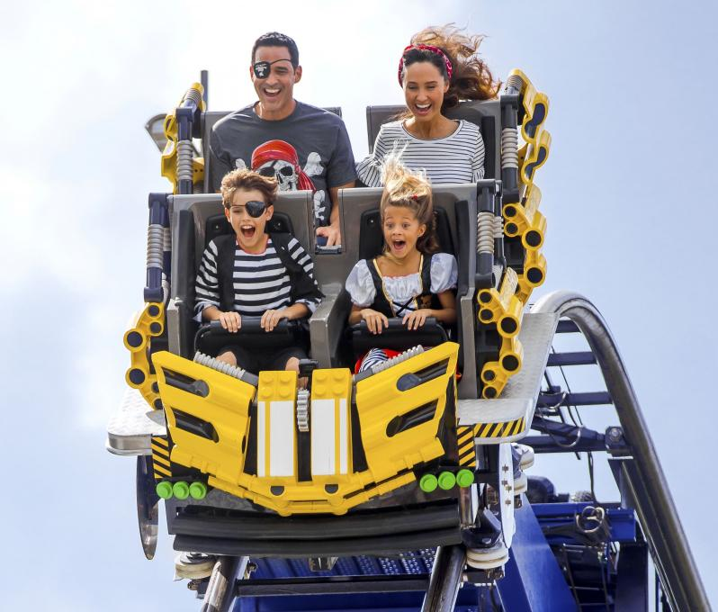 Vacationers ride a roller coaster at LEGOland in Kissimmee, Florida