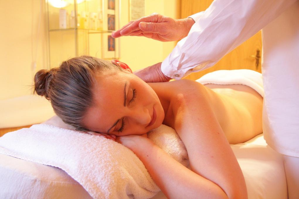 A lady receives a massage at the spa