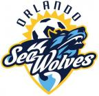 The Orlando SeaWolves logo is a multicolored blue wolf head emerging from a wave covered up by the SeaWolves name. Over the wolf head is a soccer ball sun topped with the word