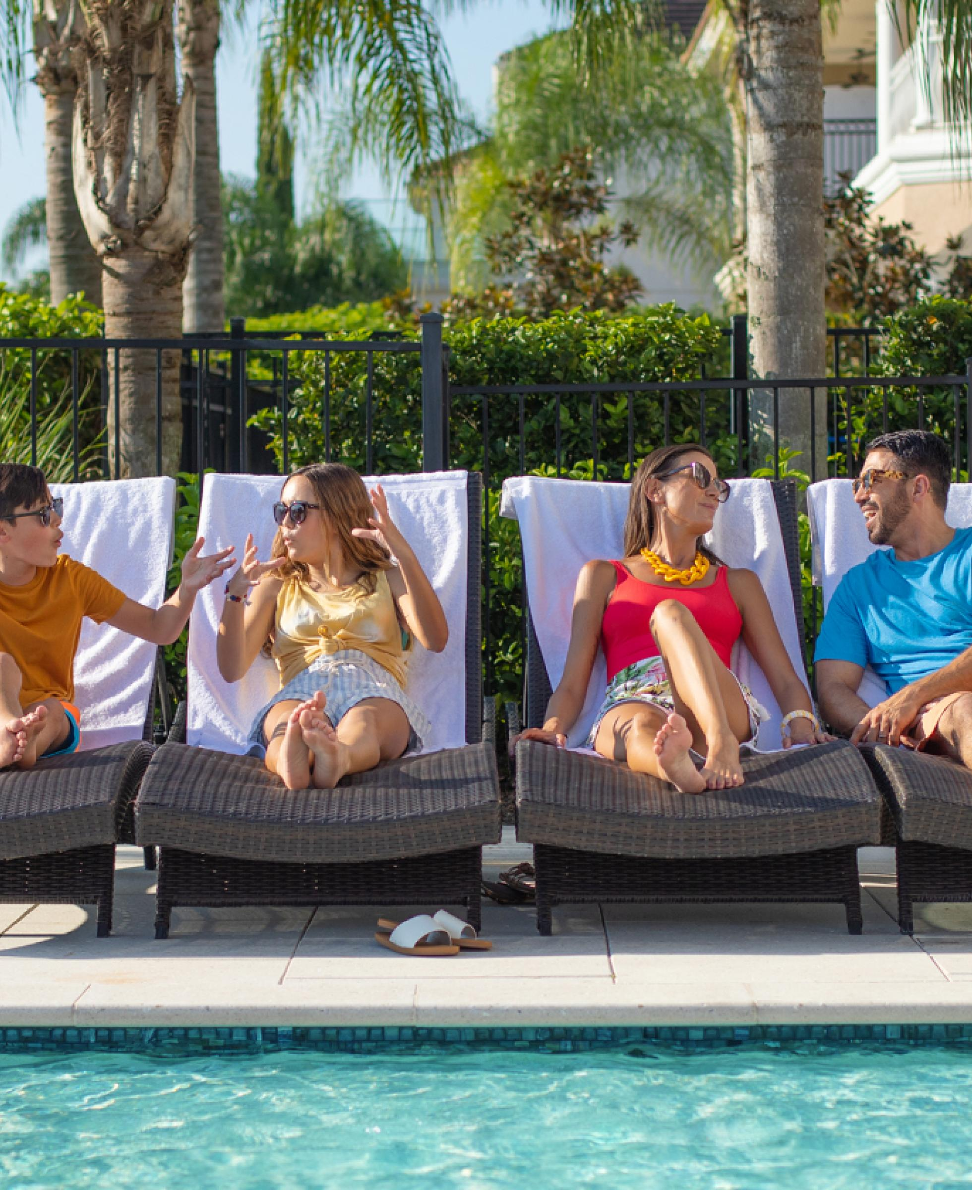 Family on pool chairs