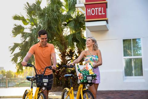 Couple outside a hotel with rental bikes