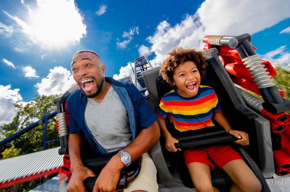 Father and son having fun on a rollercoaster