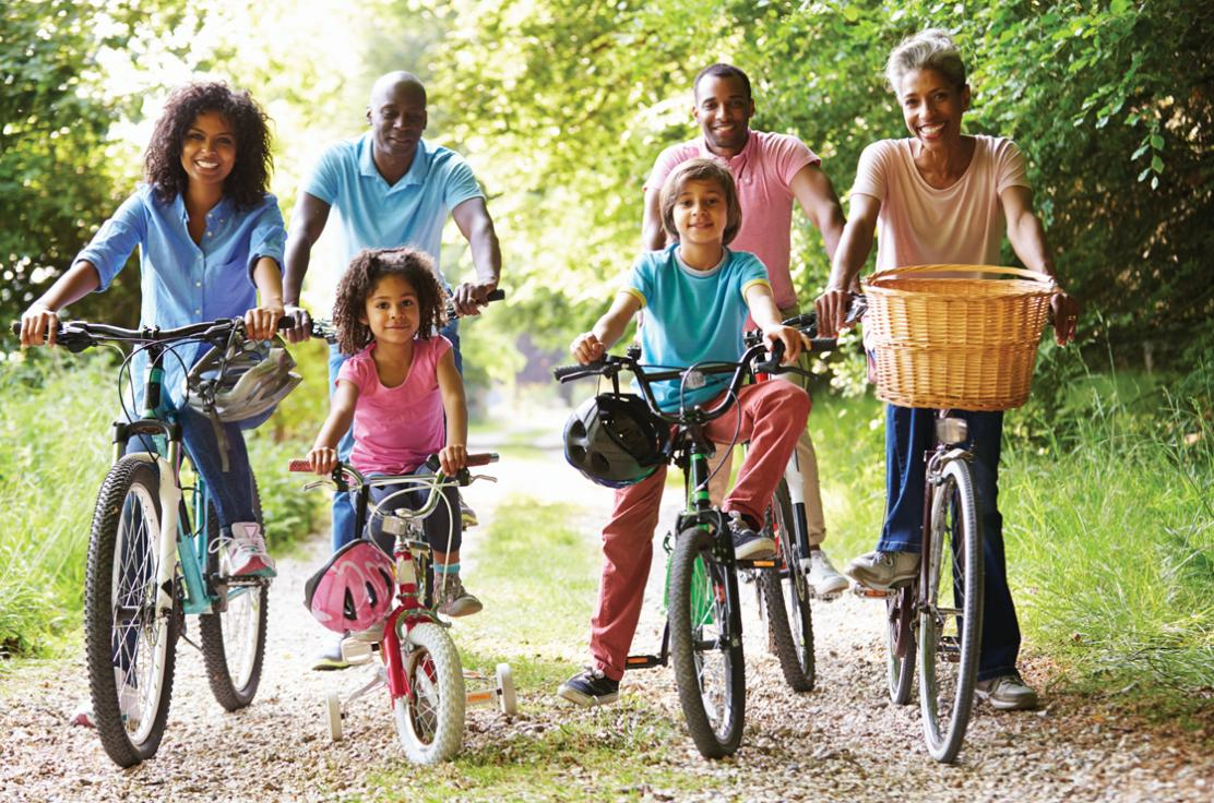 Multi Generation African American Family on cycle ride smiling at camera