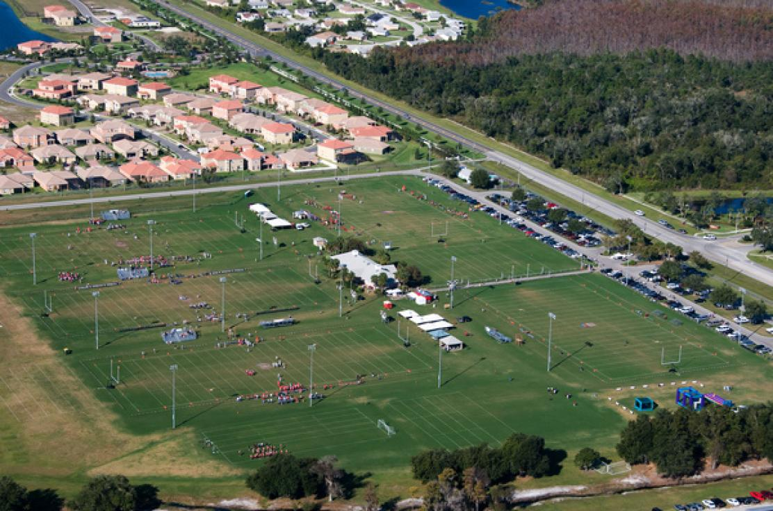 An aerial view of an outdoor sporting ground comprised of several fields of play.