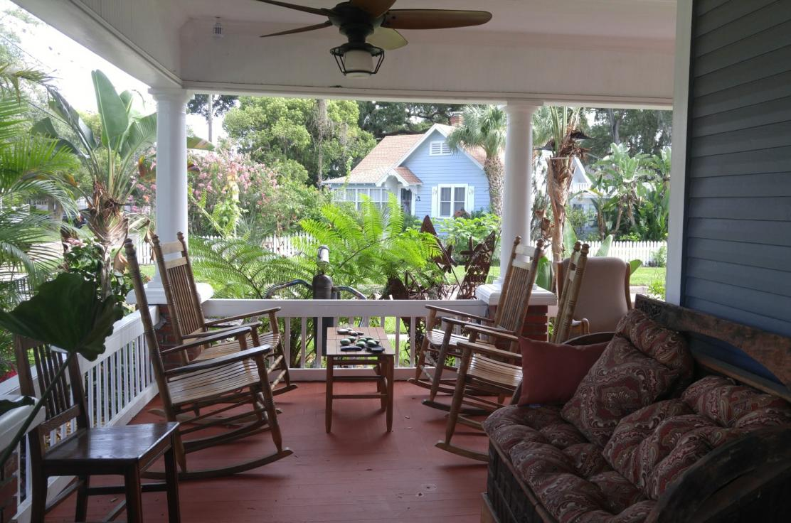 Our wraparound porch and rocking chairs gives you an inviting break from a busy day.