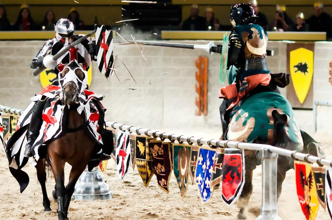 a joust between the black and white knight and the green knight