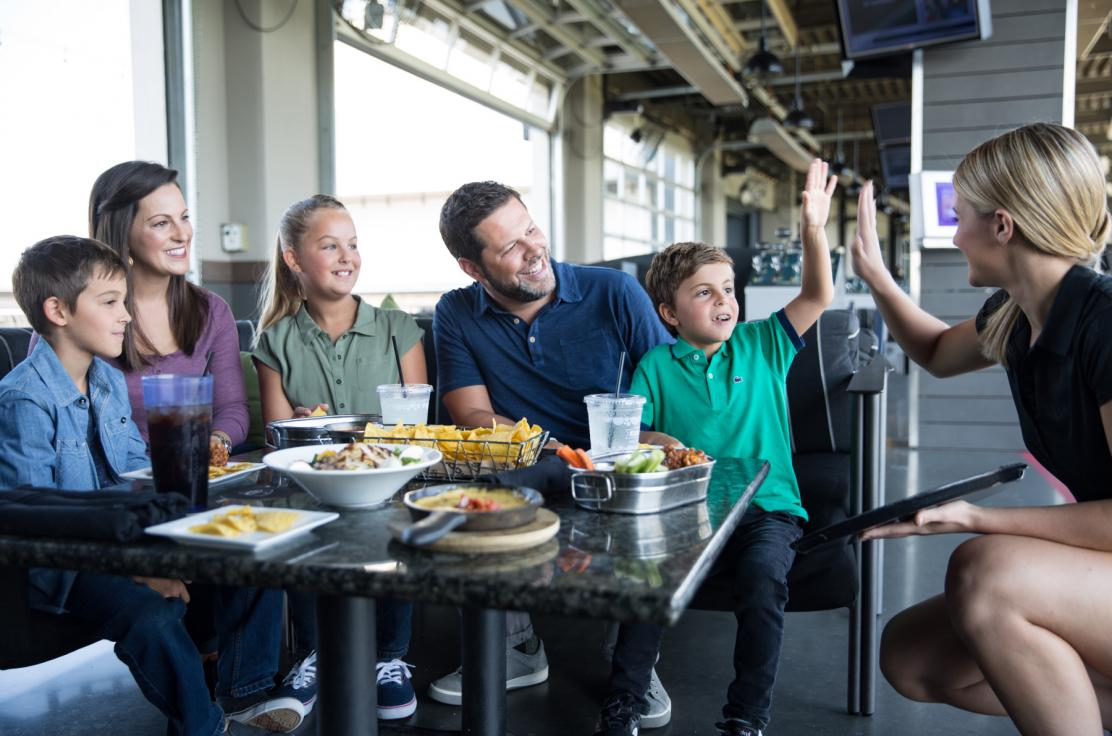 Families are welcome at Topgolf Orlando!