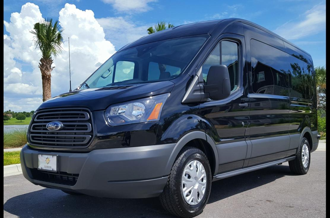 This is a photo of our main vehicle, a medium roof, black, 15-passenger Ford Transit.