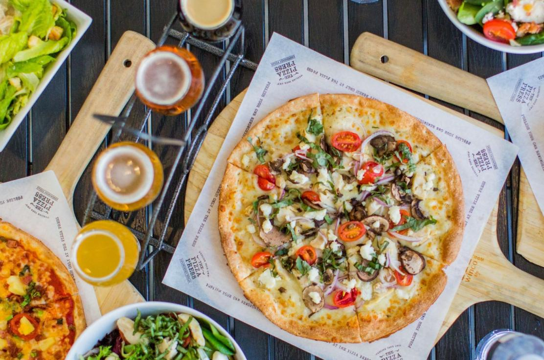 "Pizza lovers are encouraged to craft their story by ""publishing"" a pizza or choosing one of the signature pizzas named after major American newspapers such as ""The Times"", ""The Tribune"", and ""The Chronicle"", to name a few. In addition to t"
