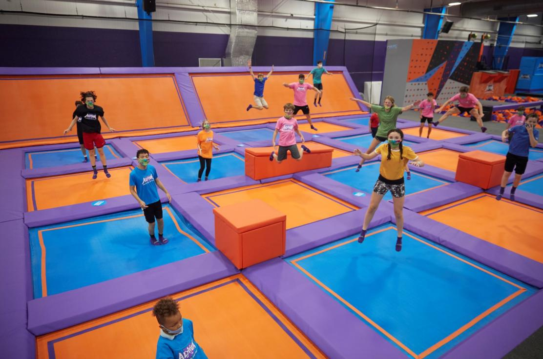 Kids jumping in C3 Certified Clean Trampoline Park with masks on.