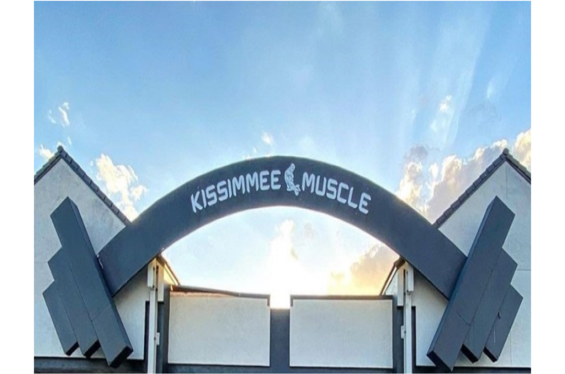 Iconic barbell over Kissimmee Muscle 24 Hour Gym