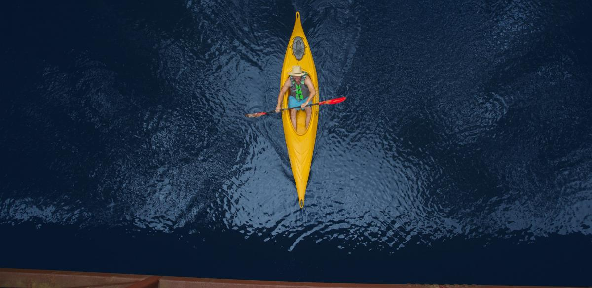 aerial shot from above of man in kayak