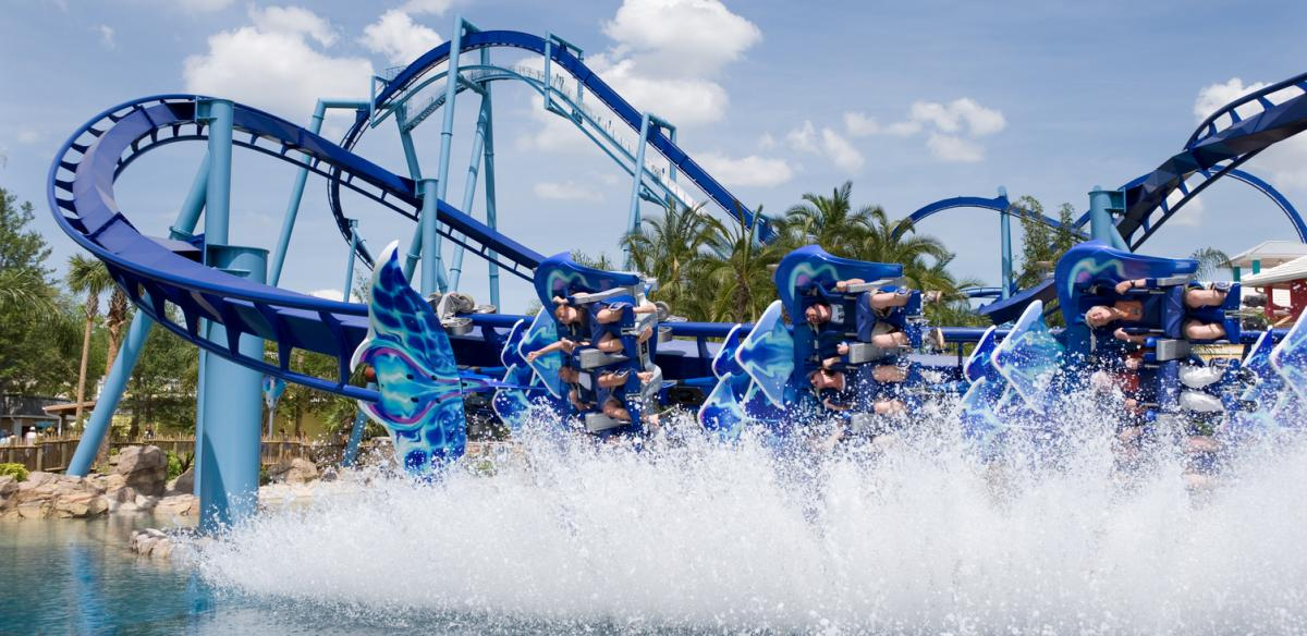 Riders getting splashed by the Wing Dipping Manta Coaster at SeaWorld Orlando