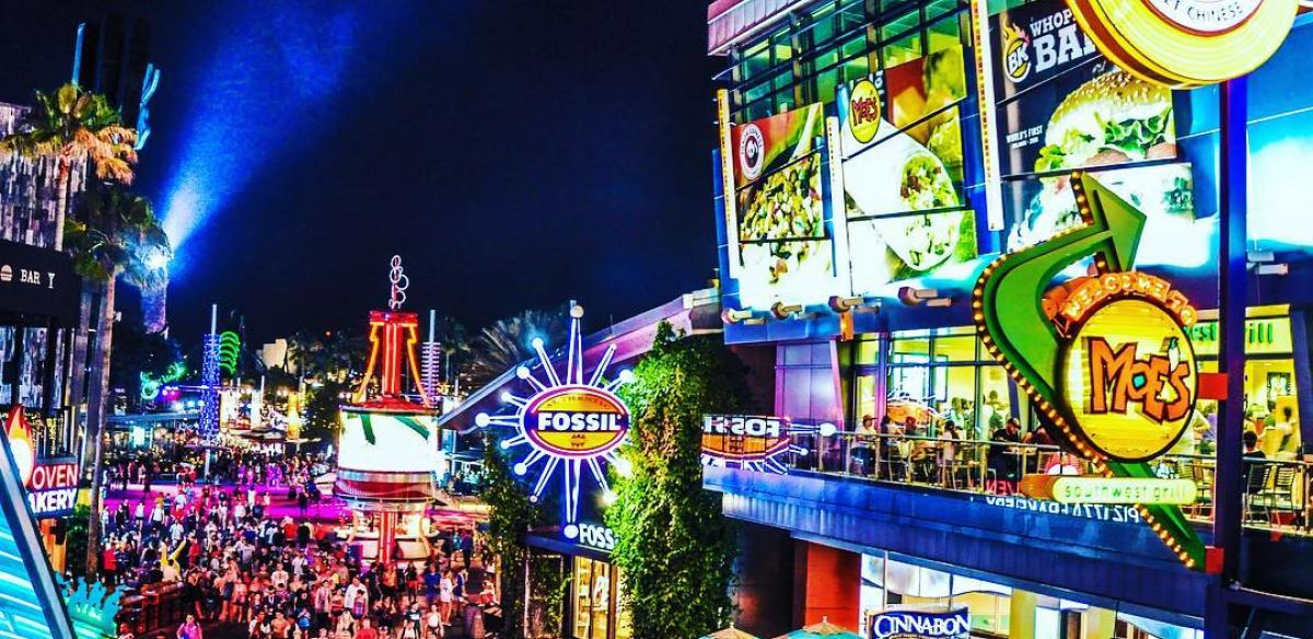 Citywalk in Kissimmee, Florida is aglow with neon signs at night.