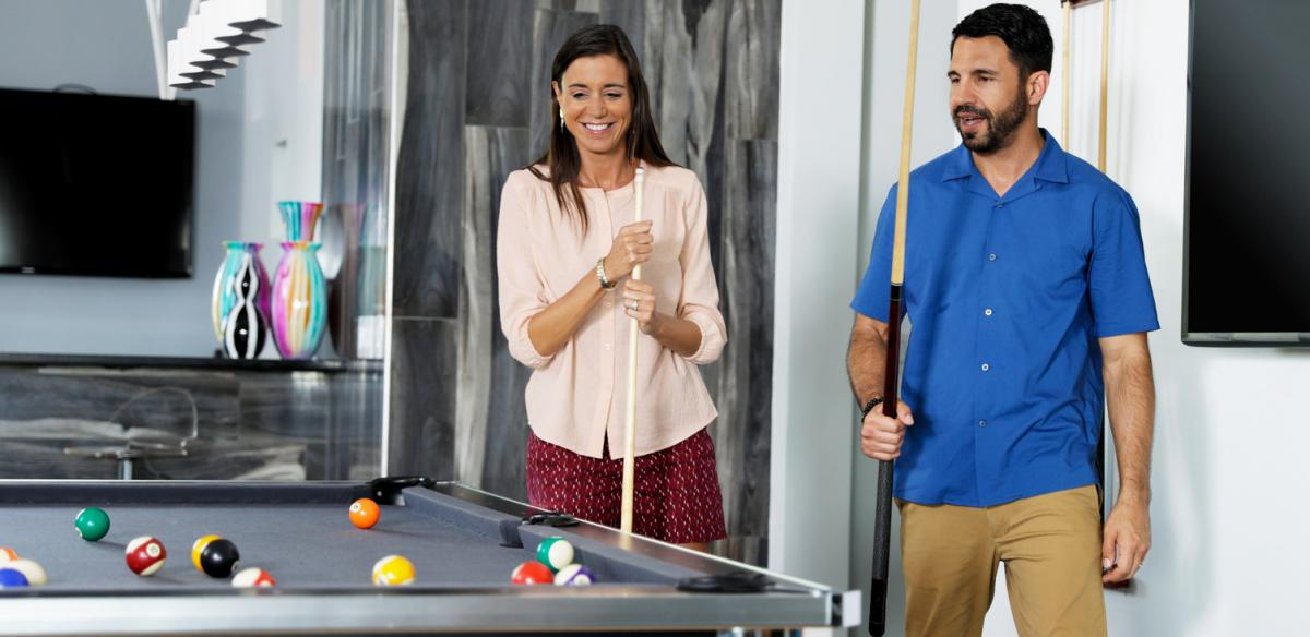 A Couple Plays Pool in a Vacation Home in Kissimmee