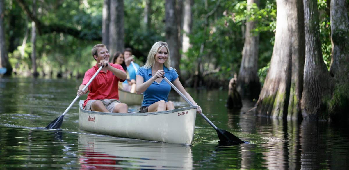 Couple canoeing on the creek.