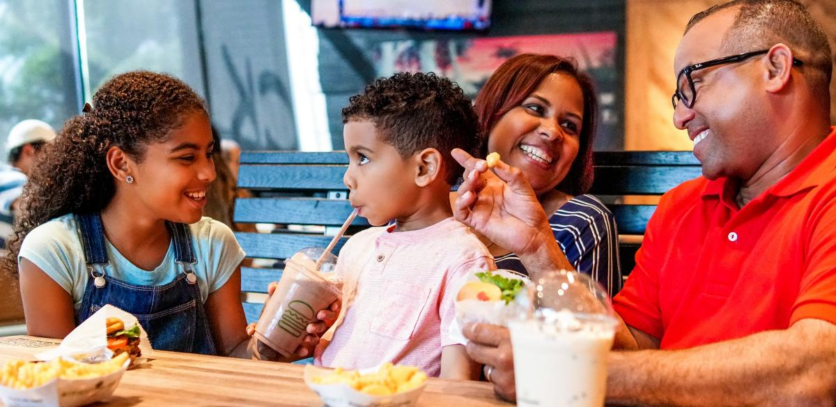 A family enjoys a meal in Kissimmee, Florida