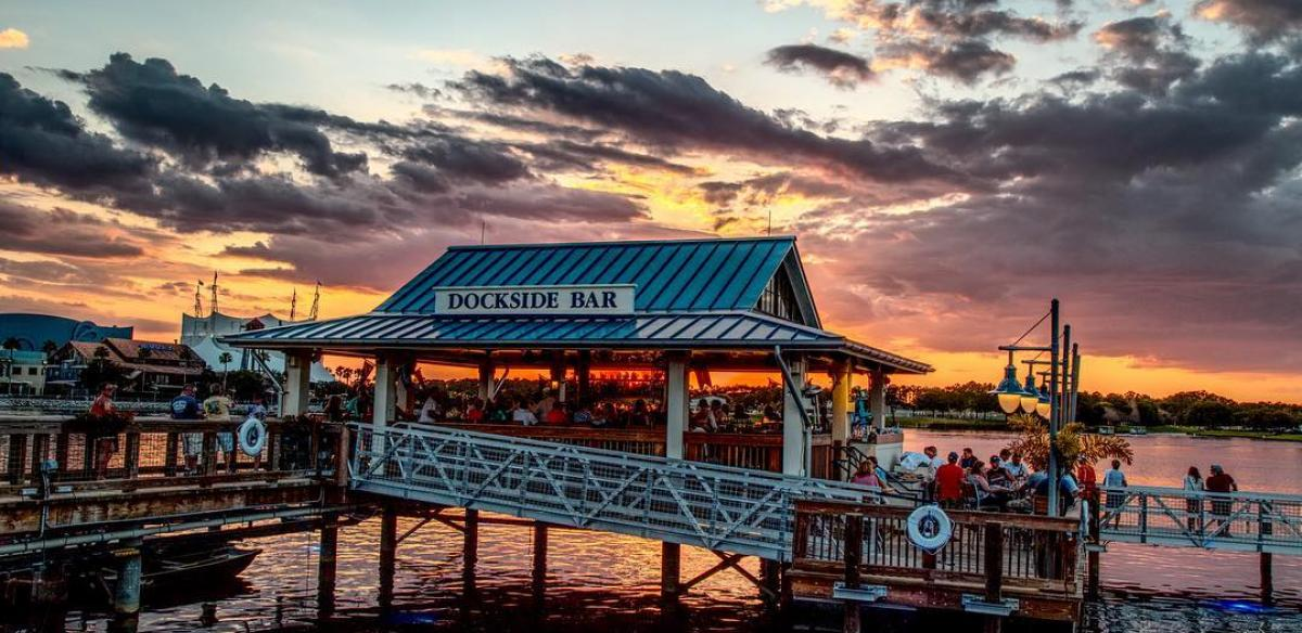 A stunning orange and pink sunset over a restaurant called the Dockside Bar in Kissimmee.