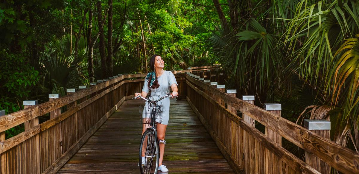 A woman biking in nature