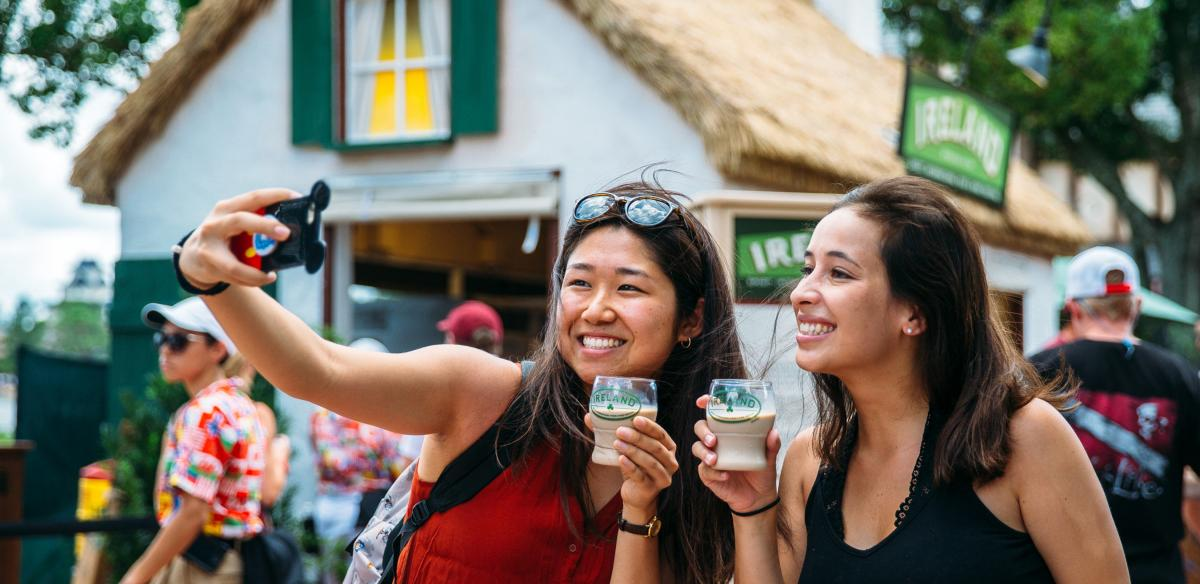 Women posing for a selfie with glasses of Bailey's Irish Cream in their hand