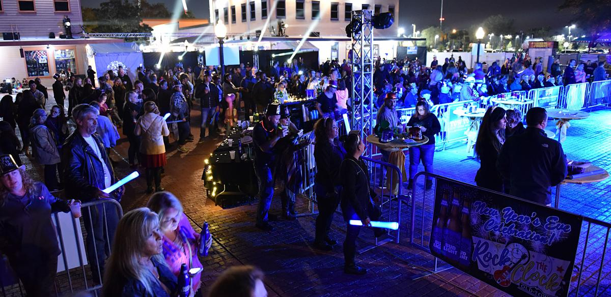 People gather for live entertainment in Old Town Kissimmee