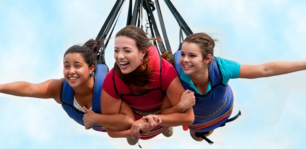 Three women enjoy a thrilling ride on the Skycoaster in Kissimmee.