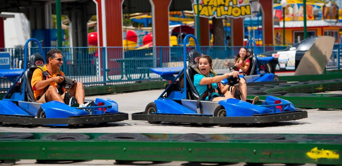 A father and her daughter race around a Go Kart track in Kissimmee, Florida.
