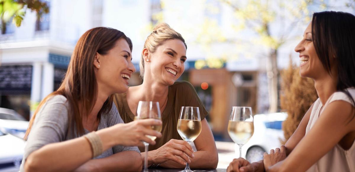 Women enjoying a glass of wine.