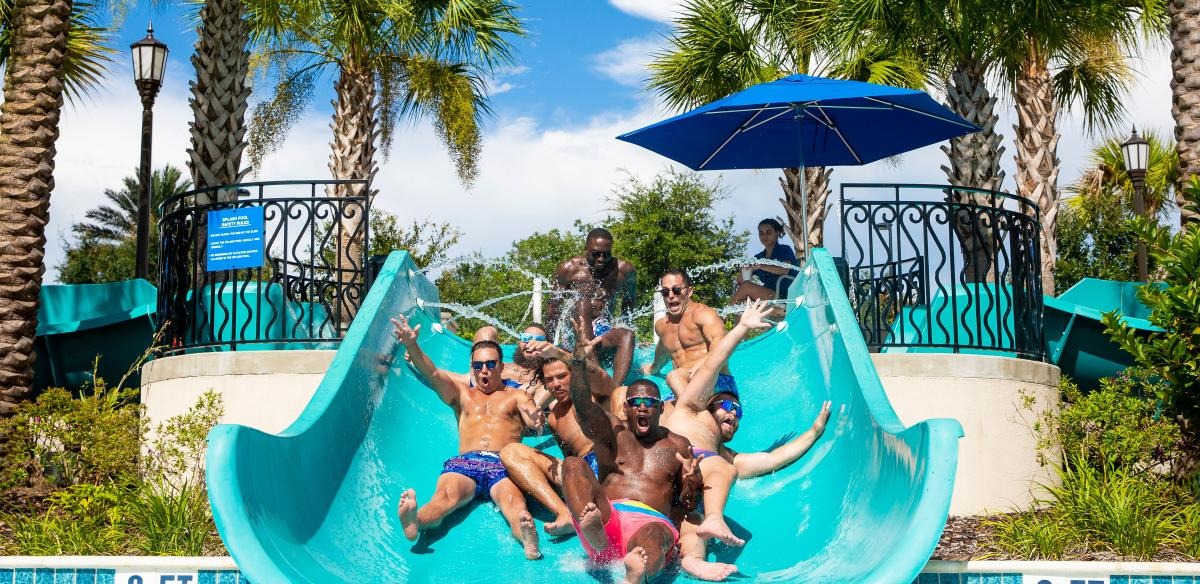 Chubbies models slide down a slide together