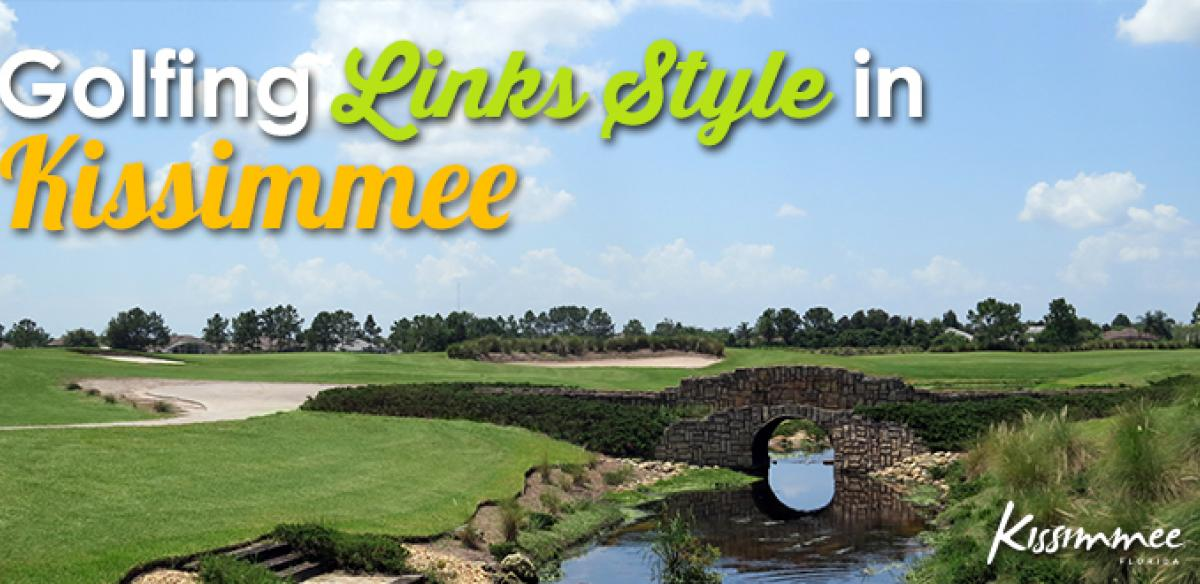 A golf course with a stone bridge and writing saying,