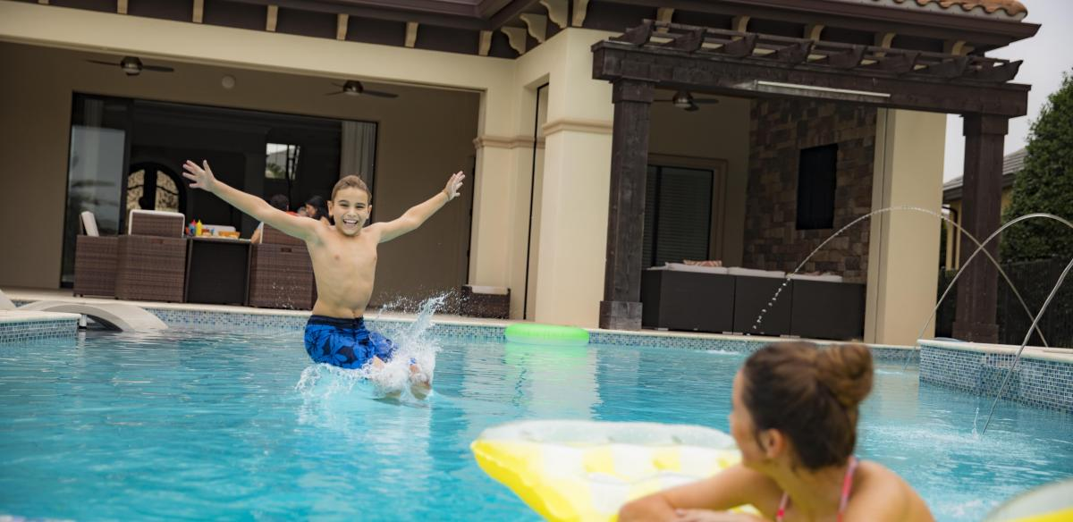 Two children splash around in a swimming pool in Kissimmee, Florida.
